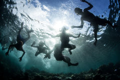 Solomon Islanders Having Fun in the Ocean. Young Solomon Islanders swim on the edge of a coral reef. People in this Melanesian region depend on the sea for much Stock Photo