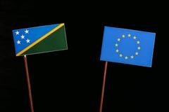 Solomon Islands flag with European Union EU flag  on black Stock Photos