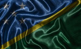 Wallpaper by Solomon Islands flag and waving flag by fabric. stock photography