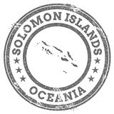 Solomon Islands grunge rubber stamp map and text. Royalty Free Stock Photo