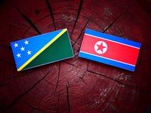 Solomon wyspy zaznaczają z koreańczyk z korei północnej flaga na drzewnym fiszorku Obraz Royalty Free