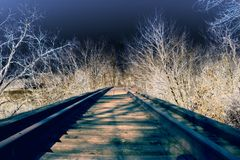 Solorized Railroad. An abstract solorized scene of a railroad bridge and tracks Royalty Free Stock Image
