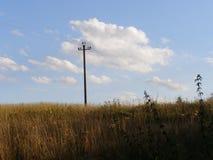 Solos posts de la electricidad en estepa Foto de archivo libre de regalías