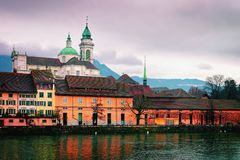 Waterfront of Saint Ursus Cathedral of Solothurn Switzerland. Solothurn, Switzerland - January 3, 2014: Waterfrontof Saint Ursus Cathedral in Solothurn royalty free stock images