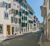 Solothurn, SO / Switzerland - 2 June 2019: historic old town cobblestone street in the Swiss city of Solothurn with ist medieval. Bourgoisie houses on stock images