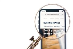 SOLOTHURN, SWITZERLAND - NOVEMBER 11, 2018: Kuehne Nagel logo displayed on a modern smartphone. Enlarged with a magnifying glass royalty free stock image