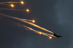 Soloturk F16 Fighting Falcon and flares Stock Photos