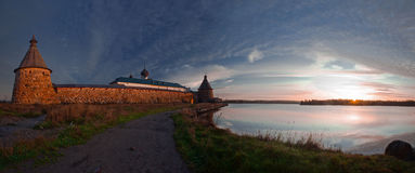 Solovetsky Monastery. Panoramic view on Solovetsky Monastery and Holy Lake on sunrise. Russia stock photo