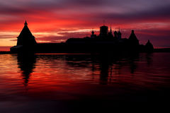 Solovki Island, Russia.Fantastical Beautiful Sunset Above The Holy Lake with Silhouette Of The Solovetsky  Monastery Stock Photography
