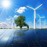 Solpaneler - vindturbiner - kraftledning Royaltyfri Foto