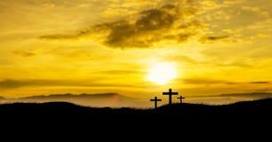 Solresning på tre kristna kors Royaltyfri Foto