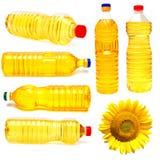 Solros och en flaska av solrosolja royaltyfri foto