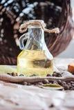 Solrosolja, bröd och kryddor och korg Royaltyfri Foto