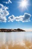 Solsken på stranden arkivfoto