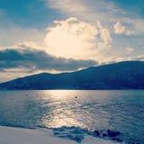 Solsken på vintersjön Fotografering för Bildbyråer