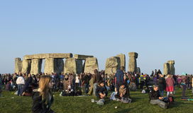 Solstice morning at Stonehenge. Stonehenge on the 21st June 2014 with stones reflecting the sun and the crowds who came for the Solstice stock photography