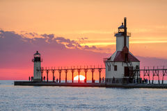 Solstice Sundown at St. Joseph Lighthouses. On the Summer Solstice, the sun sets on Lake Michigan between the Inner and Outer North Pier Lighthouses at St Stock Photography