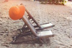 Solstolar på stranden med kokosnöten Royaltyfria Foton