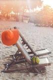 Solstolar på stranden med kokosnöten Fotografering för Bildbyråer