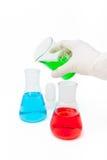 Solução colorida em umas garrafas do laboratório Foto de Stock Royalty Free