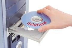 Solución del disco de la mano y del ordenador Fotografía de archivo libre de regalías