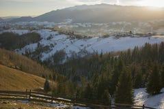 Soluppgång över by Royaltyfri Fotografi