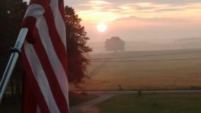 Soluppgång över Amerika Arkivbilder