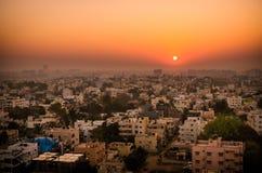 Soluppgång över Bangalore Arkivbilder