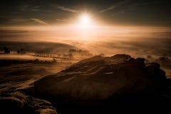 Soluppgång över den Armscliffe brant klippa i North Yorkshire royaltyfri foto