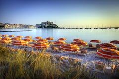 Soluppgång över den Calvi stranden Fotografering för Bildbyråer
