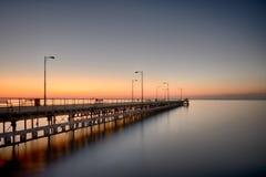 Soluppgång över den Limassol pir arkivfoto