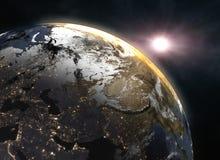 Soluppgång över jorden - Europa Arkivfoto