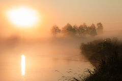Soluppgång över laken Arkivfoton
