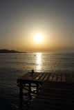 Soluppgång över skeppsdockan arkivfoto