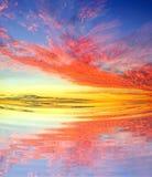 Soluppgång över soluppgångstranden Arkivfoto