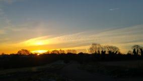 Soluppgång över Westcote Arkivfoto
