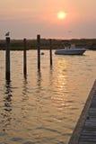 soluppgång för 2 pir Fotografering för Bildbyråer