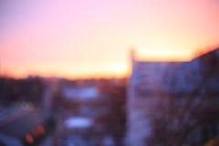 Soluppgång för Bokeh bakgrundsstad Arkivfoton