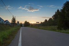 Soluppgång i by royaltyfri foto