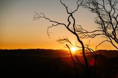 Soluppgång i dalen Arkivbild