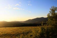 Soluppgång i morgonen, i att campa på Diable vert Arkivbild