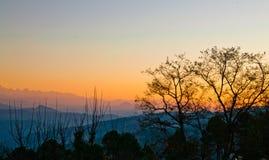 Soluppgång i uttrakhnad Arkivfoto