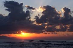 Soluppgång med molnig himmel royaltyfria bilder