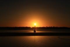 Soluppgång och fartyg Fotografering för Bildbyråer