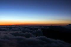 Soluppgång ovanför molnet Fotografering för Bildbyråer