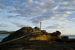 Soluppgång på den Castlepoint fyren | Nya Zeeland Arkivbild