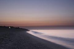 Soluppgång på det italienska härliga havet Arkivbild