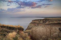 Soluppgång på en klippa Arkivfoto