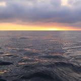 Soluppgång på havet Fotografering för Bildbyråer