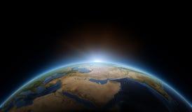 Soluppgång på jord Royaltyfria Bilder